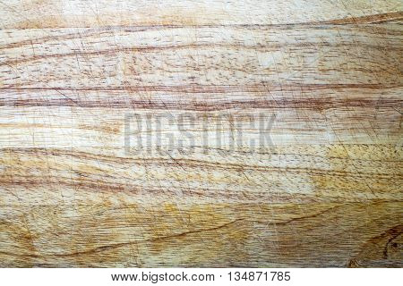 Wooden chopping board texture covered in score marks from knife usage over time