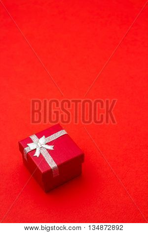 Red square gift box on red background