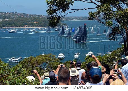 Sydney, Australia - December 26, 2014. Spectators are watching the race from Mosman. The Sydney to Hobart Yacht Race is an annual event, starting in Sydney on Boxing Day and finishing in Hobart.