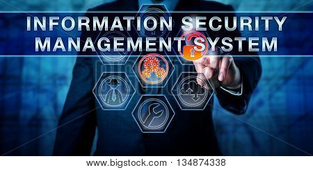 Male enterprise data manager is touching INFORMATION SECURITY MANAGEMENT SYSTEM on a virtual interactive control monitor. Business metaphor IT and data security concept abbreviated as ISMS.