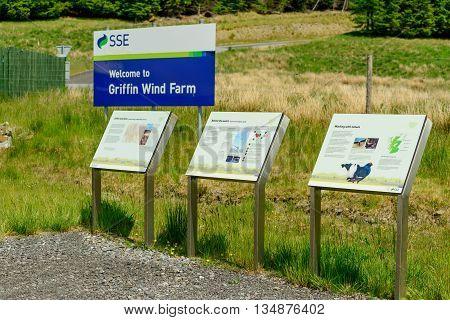 ABERFELDY SCOTLAND - JUNE 06 2016: Sign and interpretation boards at entrance to Griffin Wind Farm near Aberfeldy in Perthshire Scotland.