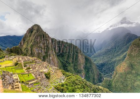 HDR of Machu Pichu in late afternoon with storm rolling in