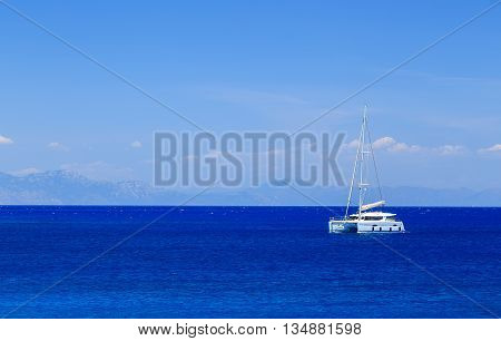 beautiful sailing yacht at sea on background of distant islands Greece