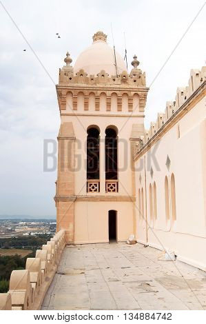 Tower and dome of Cathedral of Saint Louis of Carthage located in Carthage, Tunisia. It is an old Roman Catholic Cathedral situated near the Carthage National Museum on the hill of Byrsa
