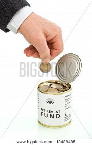Senior Man Hand Putting Coin In Retirement Fund