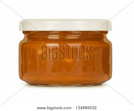Jar of peanut butter isolated on a white