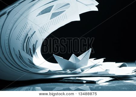 Business concept, paper boat and tsunami documents