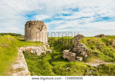 The ruins of the ancient fortress in Crimea, Inkerman. The ruins of the ancient city. The fortress on the cliffs. Ruined wall of ancient medieval fortress. Remains of an ancient fortress