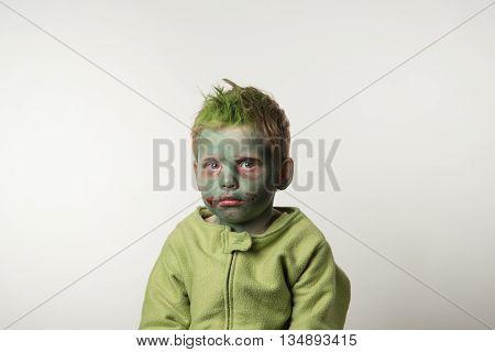 Little boy dressed as zombie on Halloween