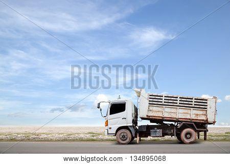 dumper truck on road blue sky background