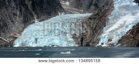 Two glaciers flowing down rock valleys met the sea