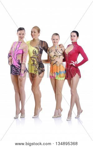 Portrait of three beautiful young rhytmic gymnasts posing