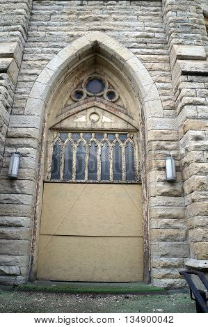 The front door of the old Saint Mary Carmelite Church, now abandoned in downtown Joliet, Illinois.