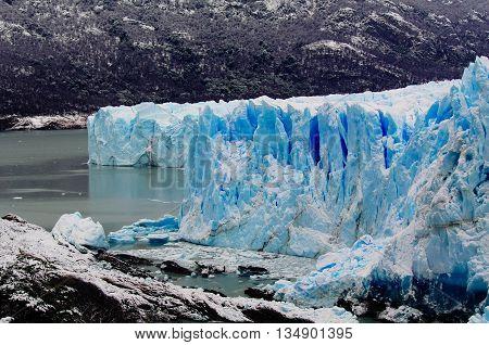 The blue ice of glacier Perito Moreno in Patagonia, Argentina
