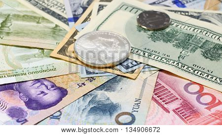 Yuan vs Dollar bank notes and coins concept business background