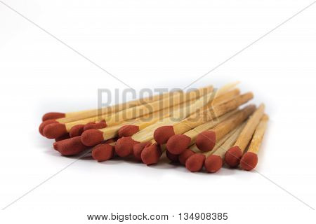 red matches close up on white background