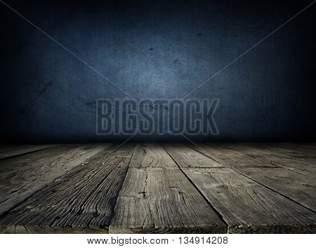 Wooden floorboards and blue wall