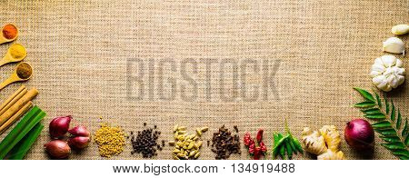 Lankan spices in  brown banner background for place text frame top view