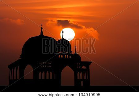 Silhouette of  Mosque on big sunset background