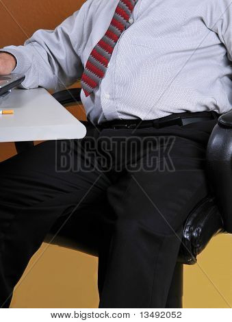Overweight business man at his desk