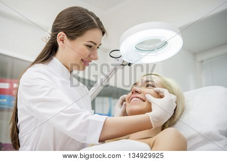 Happy female patient at a clinic visiting the doctor