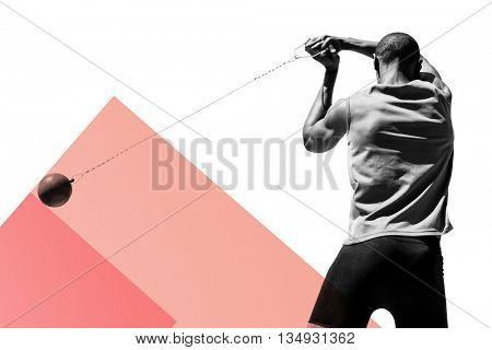 Rear view of sportsman practising hammer throw against colored background
