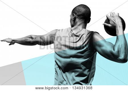 Rear view of sportsman practising discus throw against colored background