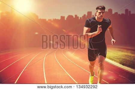 Athletic man jogging against white background against composite image of race track