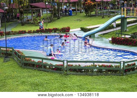 LA FORTUNA, COSTA RICA - June 5: People swim and play in a pool of hot water from the thermal spring. June 5, 2016 in Alajuela.