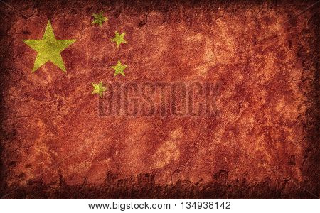 Flag of China painted onto a rough wall