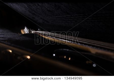bass guitar in the open case musical instrument on black background
