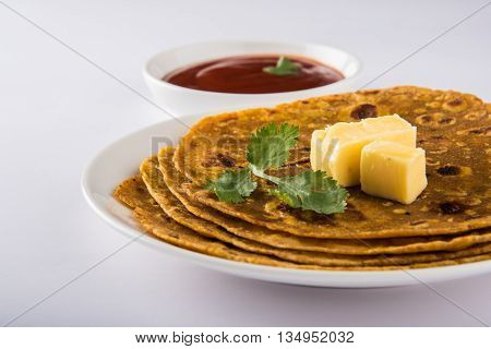 Hot delicious paratha with ghee and tomato sauce