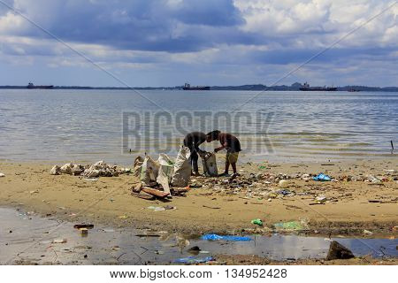 SANDAKAN, MALAYSIA - 16 JUNE 2016: Beach cleanup: refuse collection on polluted beach with plastic pollution