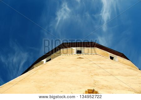 Watch tower of Spaso-Prilutsky Monastery in the Vologda city Russia. Blue sky and castle defense wall tower. Unusual view