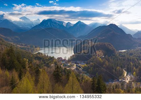 View From Neuschwanstein Castle With Hohenschwangau Castle, Alspee And Alps In The Background, South
