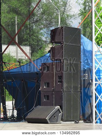 Old powerful concerto industrial black audio speakers on stage