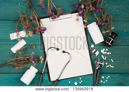 Workplace Of Doctor - Stethoscope, Medicine Clipboard, Bottle, Flower And Pils
