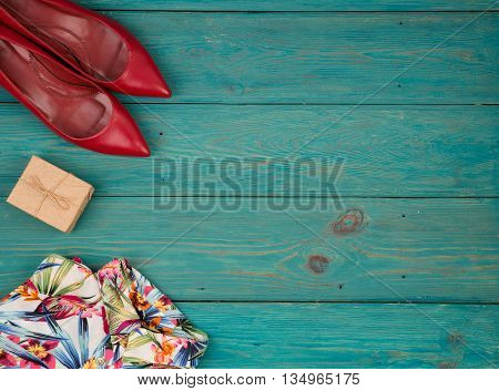 Set Of Woman Stuff On Blue Wooden Background