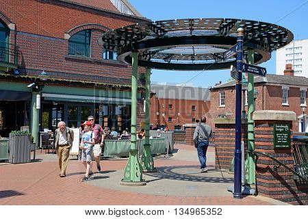 BIRMINGHAM, UNITED KINGDOM - JUNE 6, 2016 - Pavement cafes and metal bandstand at the Waters Edge in Brindleyplace Birmingham England UK Western Europe, June 6, 2016.
