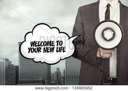 Welcome to your new life text on speech bubble with businessman and megaphone on city background