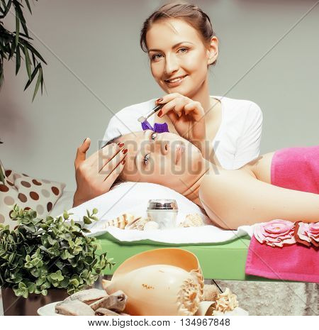 stock photo attractive lady getting spa treatment in salon, massage doctor smiling care pretty healthcare people concept