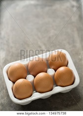 close up of a tray of rustic chicken egg