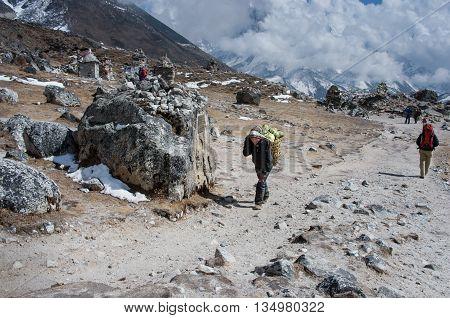 Porters Carry Heavy Load , Nepal