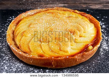 Golden Bramley apple tart with cinnamon glaze.