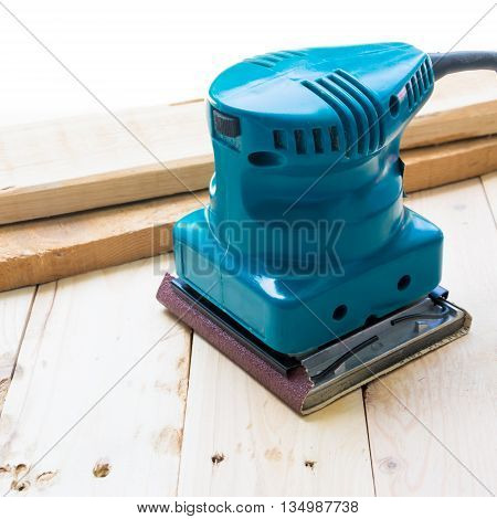 Carpenter with machine sanding for wood worker