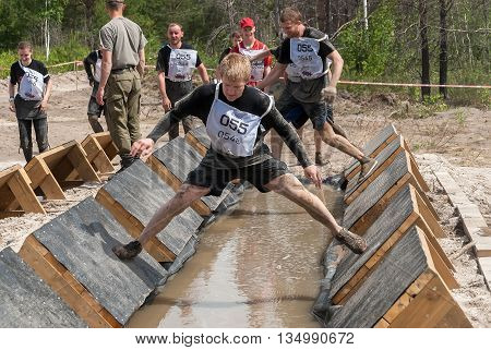 Tyumen Russia - June 11 2016: Race of Heroes project on the ground of the highest military and engineering school. Participants carry out anti-gravitation exercise