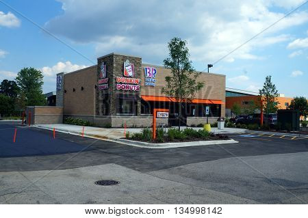 NAPERVILLE, ILLINOIS / UNITED STATES - JULY 23, 2015: People may eat Baskin Robbins' ice cream, and Dunkin' Donuts' doughnuts, in Naperville.