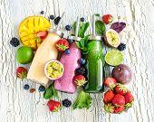 Berry and fruit smoothie in bottles healthy summer detox yogurt drink diet or vegan food concept fresh vitamins homemade refreshing cocktail poster