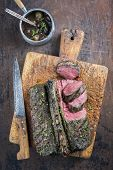 Barbecue Saddle of Venison on Cutting Board poster
