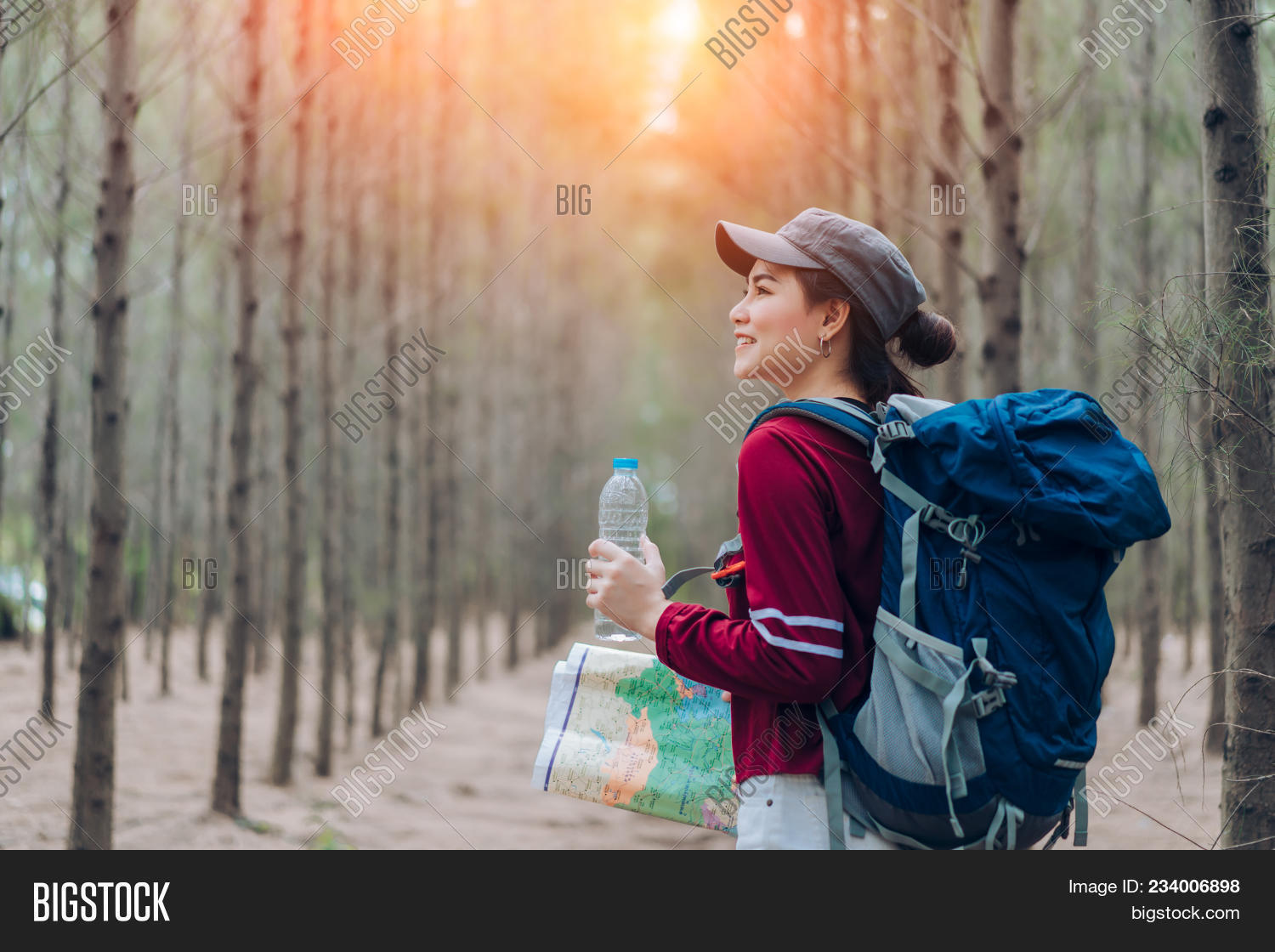 1262d4f95563 Asia woman travel with backpack,map at forest holding water go to  destinations, girl traveler doing vacation relax enjoying and hiking to mountain  travel ...